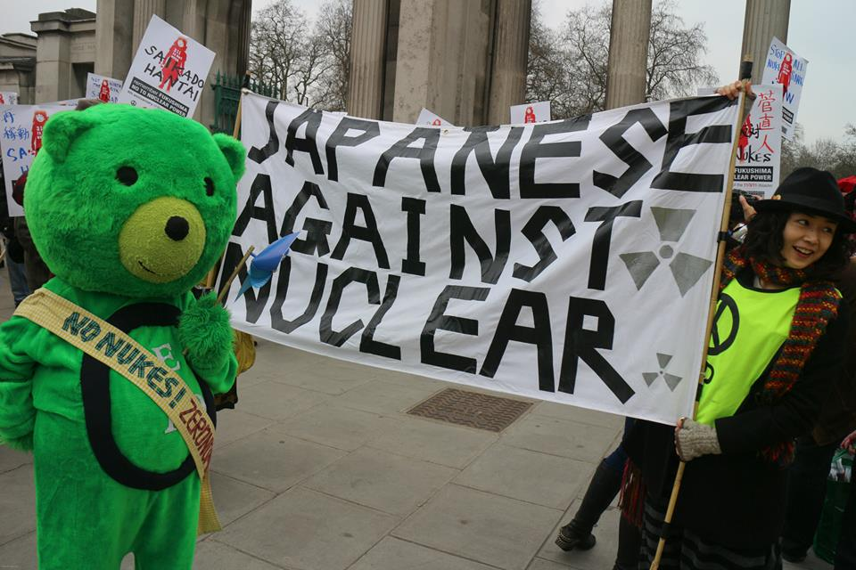 """Banner reads """"Japanese Against Nuclear"""""""