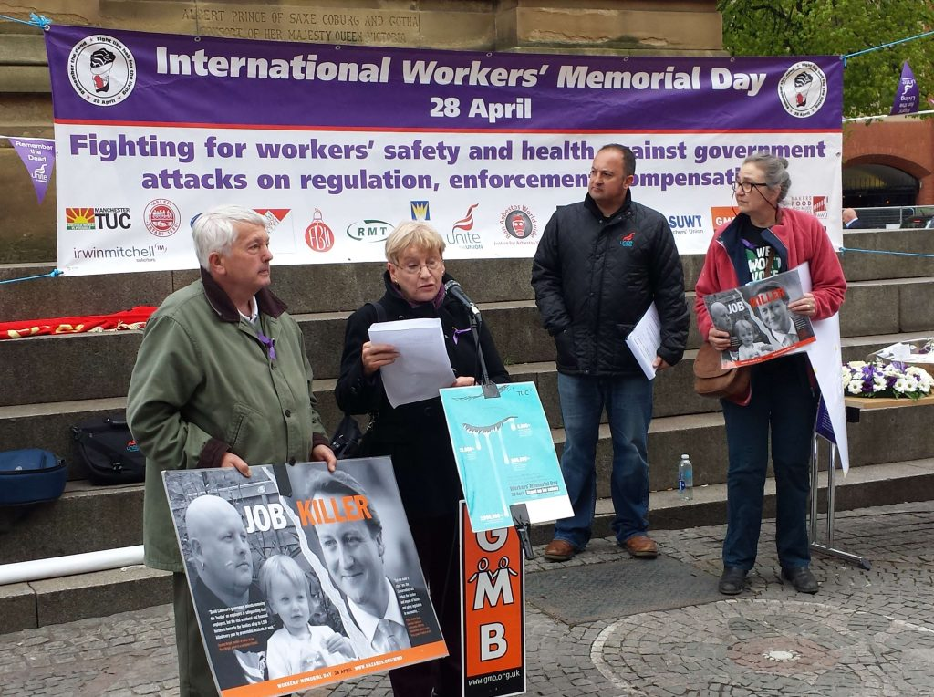 Workers' Memorial Day banner and speakers