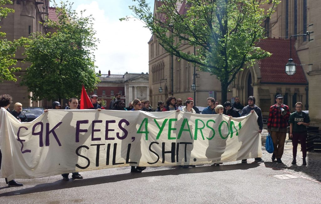 """Banner reads """"Fees: 4 years on - still shit"""""""