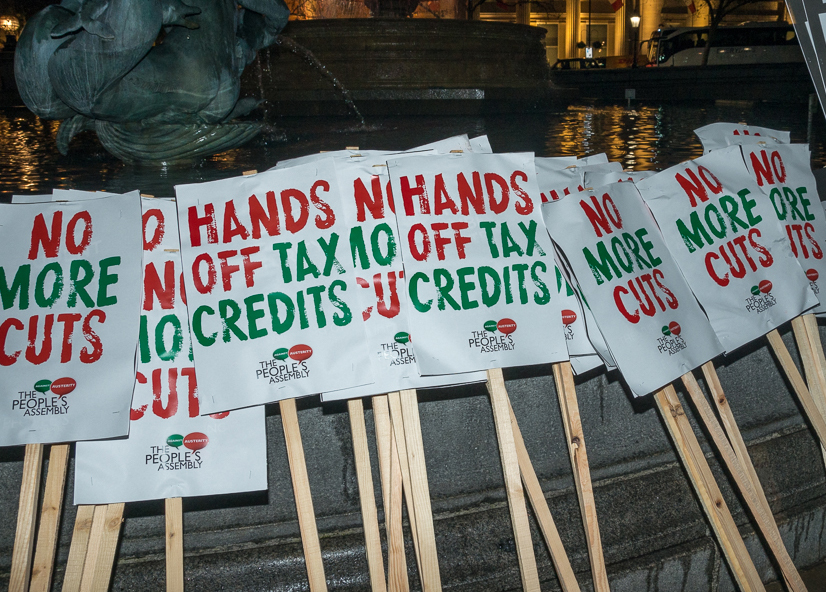 Placards reading Hands Off Tax Credits