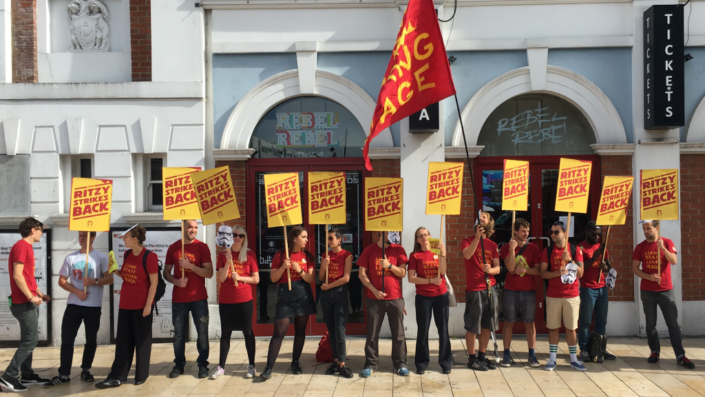 Striking workers outside the Ritzy cinema. Keywords: what is picketing strikes