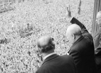 Winston Churchill waving to crowds on VE Day