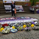 Banners, hard hats and flowers