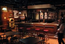 An empty bar with brown wooden furniture