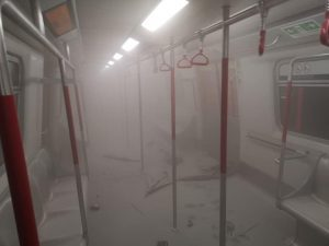 An empty carriage of the Hong Kong metro, filled with a thick fog of pepper spray.