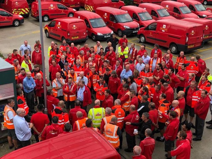 A crowd of Royal Mail workers gathing in a car park to wait for the announcement of the CWU ballot results.