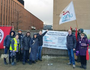 Group around Greater Manchester Unite Community banner