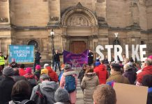 Crowd with banners and 'Strike' lettering