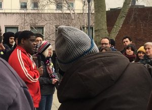Gary Younge speaking to crowd with microphone