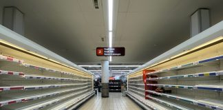 Empty supermarket shelves in a Sainsbury's store.
