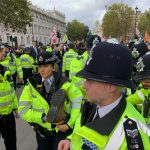 A crowd of police on Whitehall