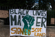 A banner that reads - Black lives matter - signed, Scotland
