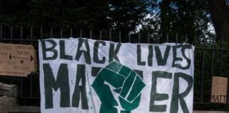 A banner that reads - Black lives matter - signed, Scotland