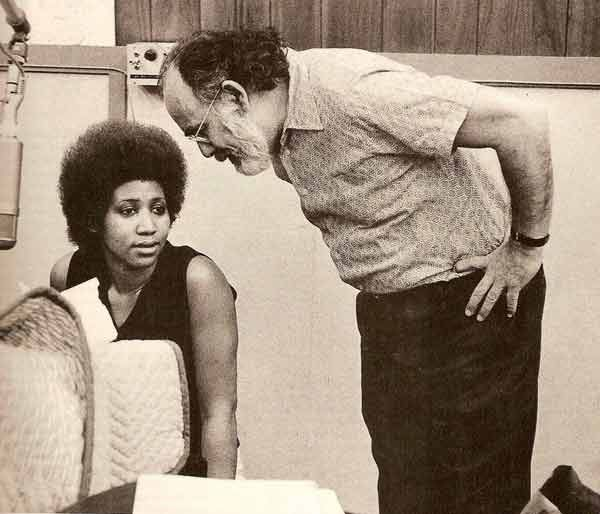 Aretha Franklin (seated on the left) and Jerry Wexler (standing on the right, leaning over)