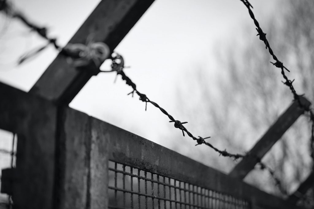 Barbed wire above a metal fence