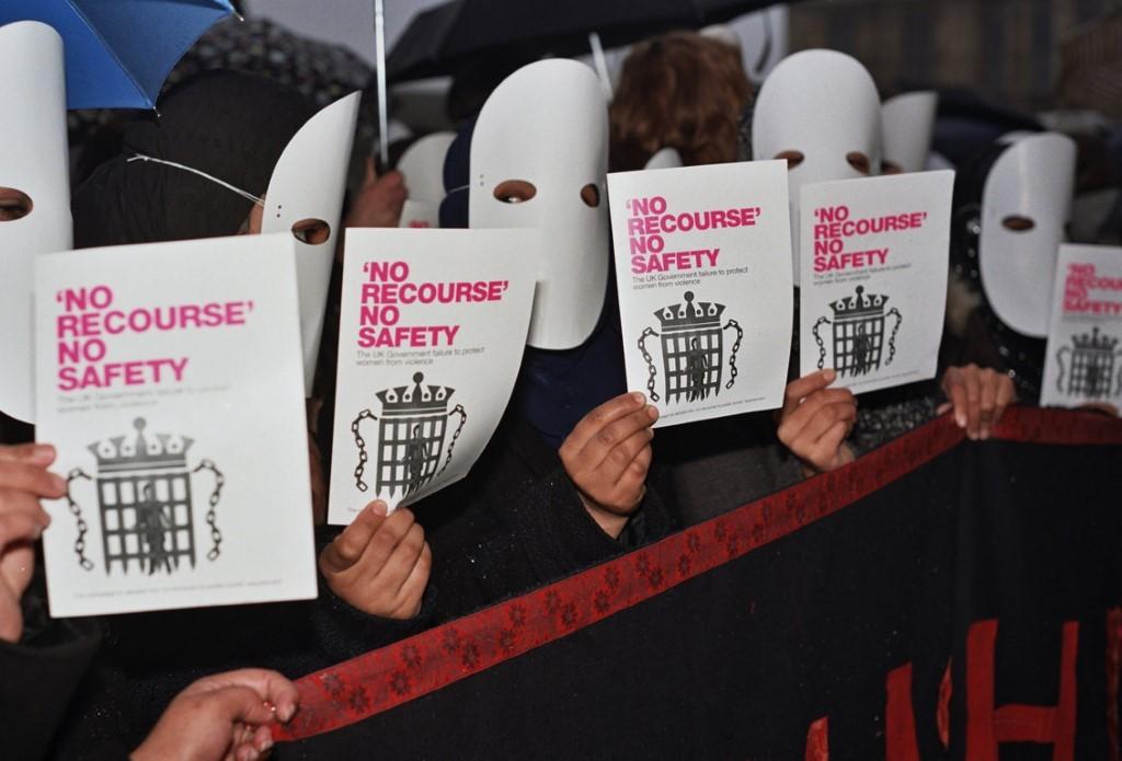 protest signs read: No Recourse No Safety