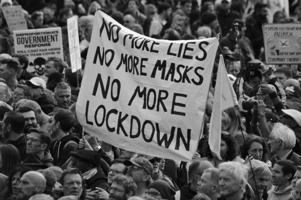 Anti-lockdown protest. Sign reads 'No more lies, No more masks, No more lockdown'.