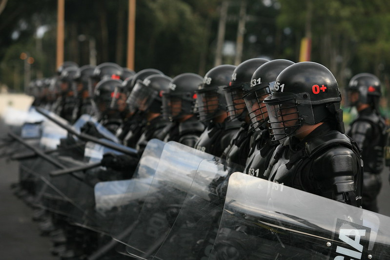 Colombian police officers. Keywords: Colombia police violence