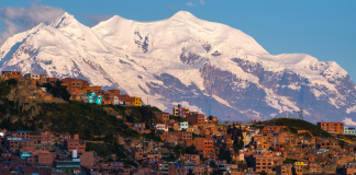 Picture of Bolivian city with mountains in background.