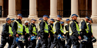 A squad of riot police march past the National Gallery in London.