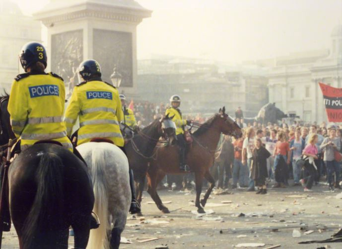 Police on horses facing poll tax protesters, March 1990.