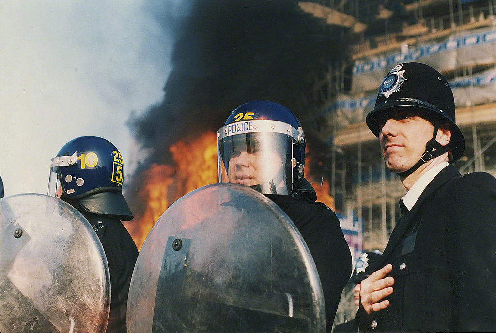 Police with riot shields at the Poll tax riot in May 1990.