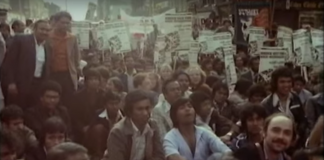 Protestors sit down outside a police station at the Battle for Brick Lane in 1978