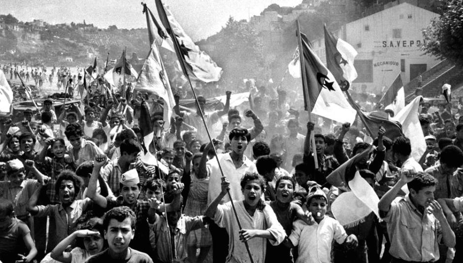 Algerians celebrating national independence in 1962. Keywords: Algerian War history