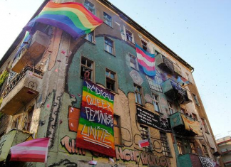 Liebig34 displaying queer feminist banners and flags.