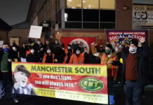 RMT members and supporters pose with banners at a picket in Longsite depot, Manchester.