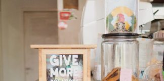 "A ""Give More"" donations box."