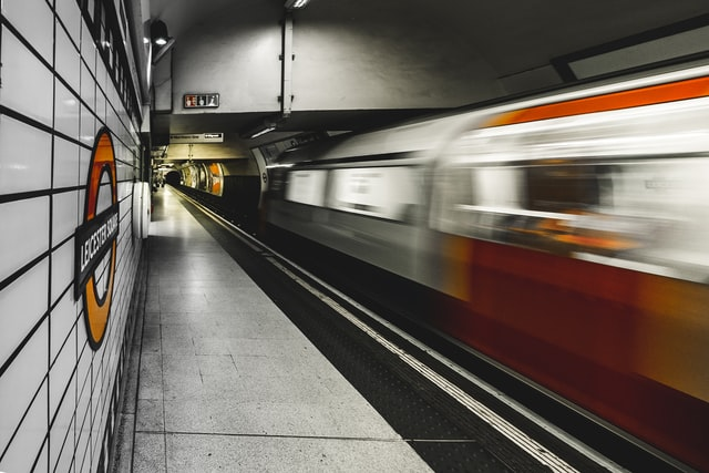 A photo of a train moving fast beside a mainly empty London Underground platform. Keywords: Section 44 workplace safety unions