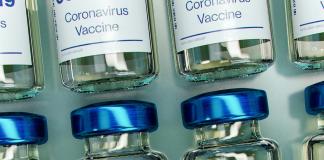 Covid vaccine bottles. Photo: Daniel Schludi / Unsplash