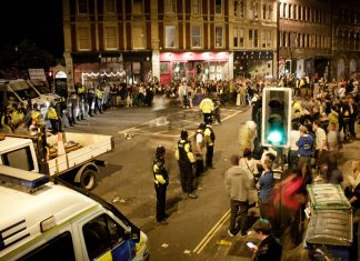 Bristol police officers moving to suppress an occupation in 2011.