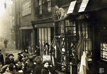 Sylivia Pankhurst addressing a crowd outside the headquarters of the East London Federation of Suffragettes, Old Ford Road, Bow