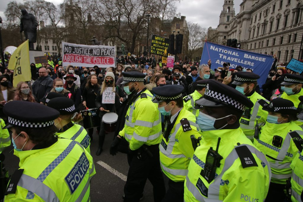 Police charged into the crowd to divide it in two in Parliament Square on Saturday. Photo: Steve Eason