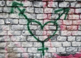 graffiti in Holyrood Park, near the Scottish Parliament showing a heart transgender symbol