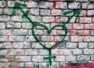 graffiti in Holyrood Park, near the Scottish Parliament showing a heart transgender symbol