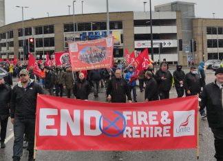 March with banners reading 'end fire & rehire' and 'Unite Queen's Road branch'