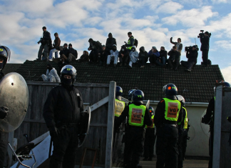Riot police surround a chalet during the Dale Farm eviction in 2011.