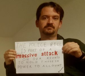"""Placard reads """"The Police Bill is part of a massive attack on our rights to hold those in power to account"""""""