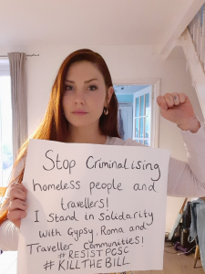 """Placard reads """"Stop criminalising homeless people and travellers! I stand in solidarity with Gypsy, Roma and Traveller communities! #ResistPCSC #KillTheBill"""