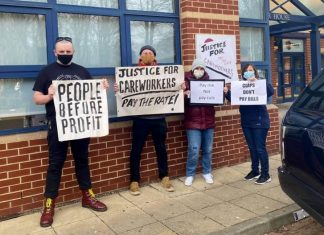 Image shows four protesters outside Mencap protesting for justice for careworkers in March 2021. Photo credit: Care and Support Workers Organise.