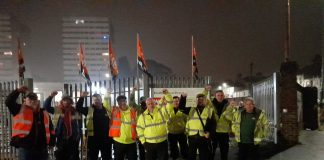 Refuse workers on strike picket their depot in Brighton with GMB flags - the Brighton refuse workers strike 2021